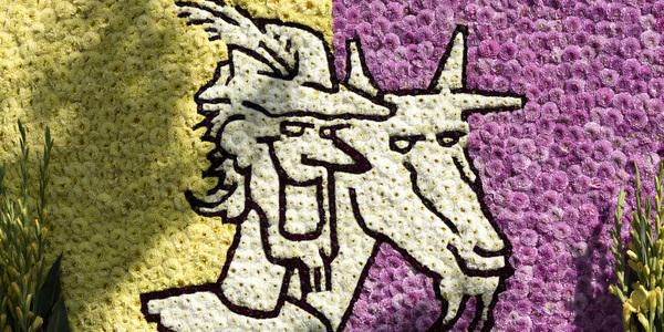Bloemenuitvoering van het logo van de Geitestoet: de hoofden van Lange Wapper en een geit
